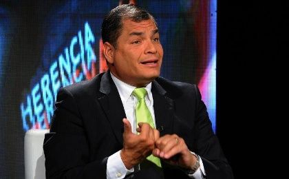Ecuadorean President Rafael Correa speaks with the press about a set of new bills he has submitted to the National Assembly address the concentration of wealth in the country, Quito, Ecuador, June 7, 2015.