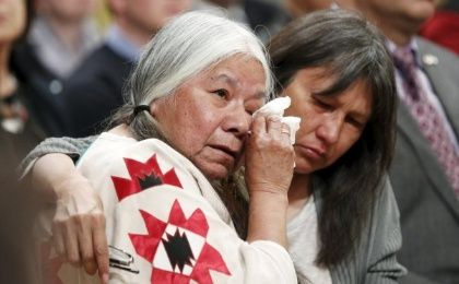 Residential School survivor Lorna Standingready, left, is comforted during the Truth and Reconciliation Commission of Canada closing ceremony in Ottawa last week.