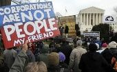 Demonstrators stage a protest near the U.S. Supreme Court building in Washington on January 20, 2012.