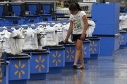 A girl walks along the checkouts at the Wal-Mart Supercenter in Springdale, Arkansas June 4, 2015.