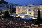 Protesters in front of the Greek Parliament in Athens on Wednesday urged Greece's European and IMF creditors to ease their terms.