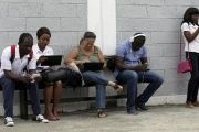 Young people use the internet via the free wifi at the studio of Cuban artist Alexis Leyva ''Kcho'' in Havana March 24, 2015.