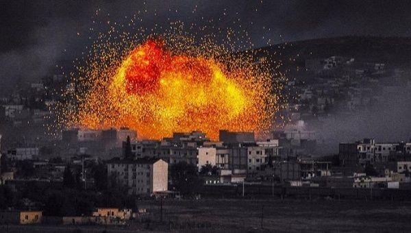 Smoke and flames rise following an explosion in the Syrian town of Kobani, also known as Ain al-Arab, as seen from the southeastern Turkish village of Mursitpinar.