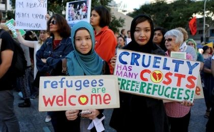 Tahera Jaffari and Sahra Heidara, from Afghanistan, protest in Brisbane, Australia, for refugee rights.