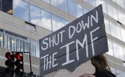Protesters rally outside the International Monetary Fund headquarters during the spring IMF-World Bank meetings in Washington.