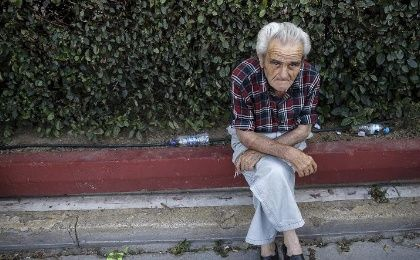 A Greek pensioner rests during protests against the new pensions cuts, June 23, 2015.