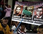 Guatemalans protest corruption of top government officials.