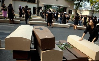 Honduran women's rights groups use coffins in a protest in capital Tegucigalpa to highlight ongoing violence against women.