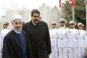 Venezuela's president Nicolas Maduro (R) is welcomed by Iran's president Hassan Rouhani in Tehran January 10, 2015.