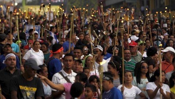 People take part in a march to demand the resignation of Honduras