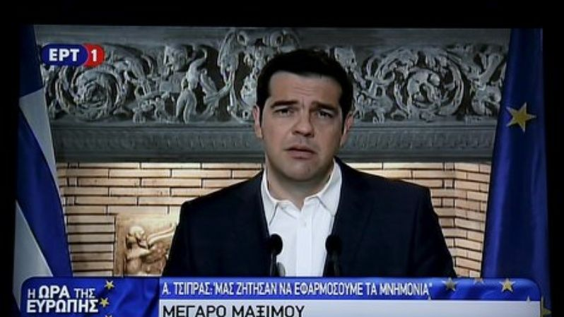 Greek Prime Minister Alexis Tsipras is seen on a television monitor whille addressing the nation early June 27, 2015.