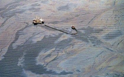 An oil skimming operation works in a heavy oil slick near Latouche Island in the southwest end of Prince William Sound on April 1, 1989.