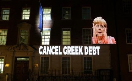 Activists projected Merkel as three wise monkeys and