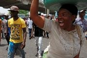 A woman shouts while participating in a march organized by sugar cane workers in Santo Domingo, Dominican Republic, June 25, 2015.