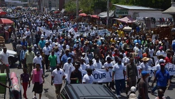 "Demonstrators in the ""march for dignity"" in Port-au-Prince, Haiti march in solidarity with Haitians facing deportation from the Dominican Republic, July 21, 2015."