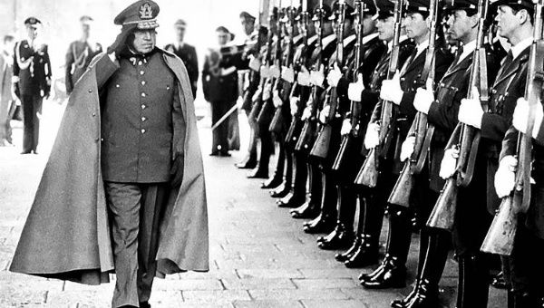 Former Chilean dictator General Augusto Pinochet reviews troops as he enters La Moneda Palace in the capital Santiago.