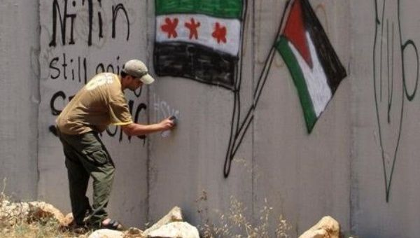 Palestinians Show Support for Syria