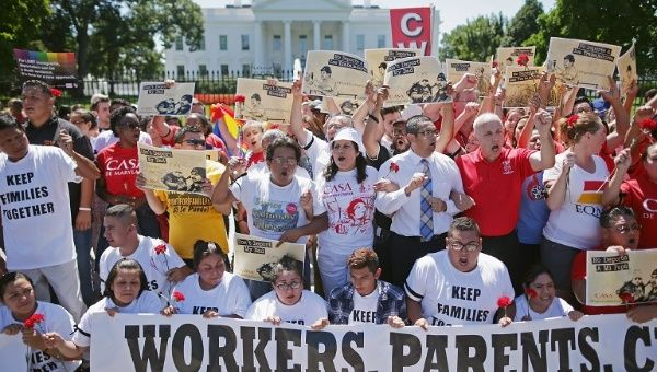 Demonstrators rallied outside the White House to demand that President Obama halt deportations, August 28, 2014. After Obama later that year announced DAPA, there has been a spike in Texas of babies being denied birth certificates.