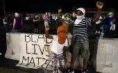 Three young protesters join the demonstration outside the police department in Ferguson, Missouri August 7, 2015.