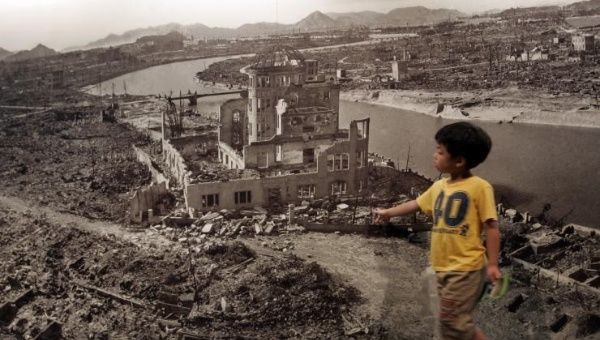 A boy looks at a huge photograph showing Hiroshima city after the 1945 atomic bombing, at the Hiroshima Peace Memorial Museum, Japan August 6, 2007.
