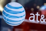 The AT&T logo is seen at a company store in Times Square in New York City.