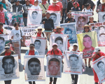 Relatives of the 43 disappeared students from Ayotzinapa demanding answers to the government