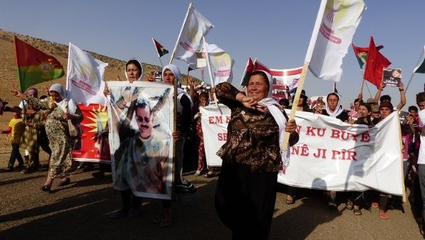 Protest march of Yazidi women in the Sinjar Mountains on the first anniversary of the Islamic State group massacre