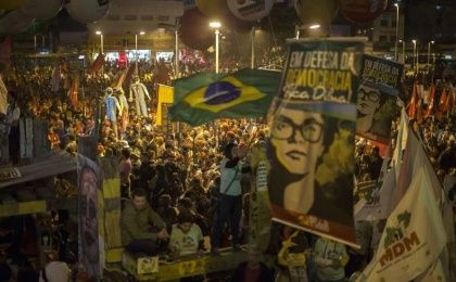 Members of social movements, unions, and left parties march in Sao Paulo, Brazil in support of president Dilma Rousseff on August 20, 2015.. The upper-class opposition has been calling for Rousseff's impeachment.