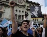 Demonstrators hold a picture of former Guatemalan President Jacobo Arbenz, during a protest against President Perez Molina in Guatemala City, Aug. 22, 2015.