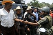 President Otto Perez Molina ordered a state of siege for 30 days in four municipalities in southeastern Guatemala after security forces clashed with opponents of a Canadian-owned gold and silver mine project.