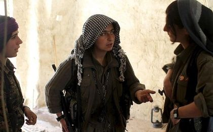 Female PKK fighters discuss tactics to reach a position which had been hit by Islamic State car bombs in Sinjar.