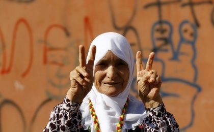 A demonstrator gestures during a march in solidarity with Kurdistan Workers Party (PKK) jailed leader Abdullah Ocalan in Diyarbakir, Turkey, August 1, 2015.