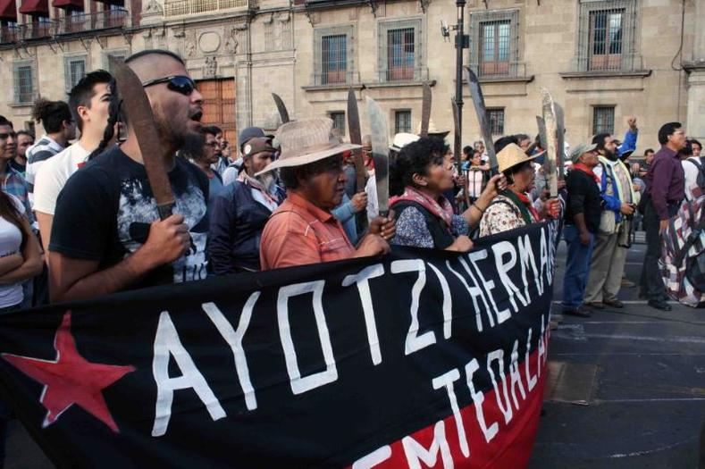The protest in Mexico City, Aug. 26, 2015, marks the 11-month anniversary of the Ayotzinapa students
