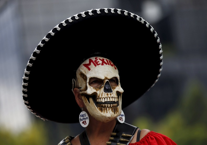 A demonstrator wearing a skull mask takes part in a protest to mark the 11-month anniversary of their disappearance in Mexico City, Mexico Aug. 26, 2015.