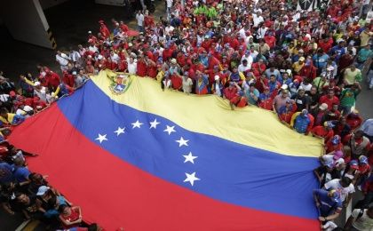 Crowds of Venezuelans have rallied in support of the government's crackdown on cross-border crime.