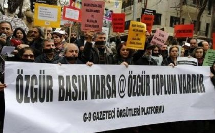 "Journalists demanding freedom for the media take part in a protest in Ankara February 15, 2014. Banner reads: ""When there is free press, there is a free society."""