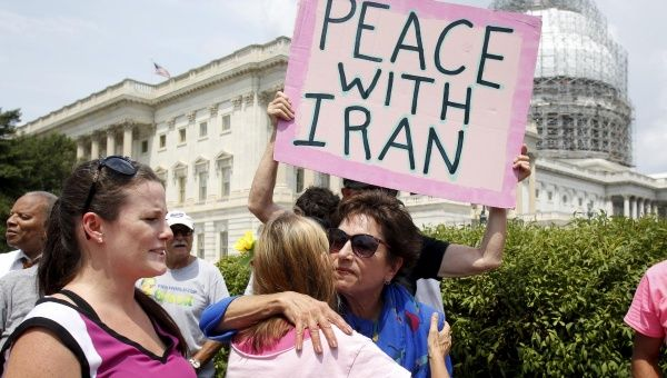 Representative Jan Schakowsky hugs a Code Pink activist at an event delivering more than 400,000 signatures to Capitol Hill in support of the Iran nuclear deal, July 29, 2015.