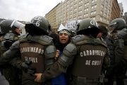 Mapuche activists try to get through riot police in a demonstration in Santiago, Chile Aug. 27, 2015 after truckers from the south arrived in the city.