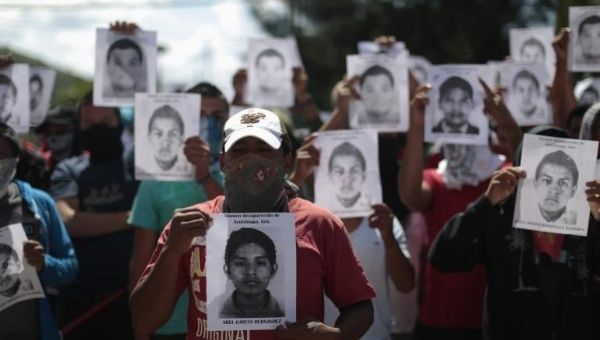 Protestors hold pictures of missing students outside the General Attorney building in Chilpancingo, in Guerrero, Oct. 7, 2014.