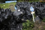 Bags of contaminated top soil in Naraha, Japan. Around 100 families have returned to the town.