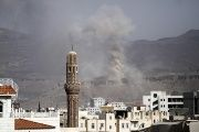 Smoke rises during an air strike on an army weapons depot on a mountain overlooking Yemen's capital Sanaa.