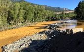 This photo provided by La Plata County in Colorado on August 10, 2015 shows the orange colored Animas River near Durango, Colorado shortly after a toxic waste spill.