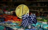 Greek flags on sale in Athens. While Greeks still support E.U. membership, they