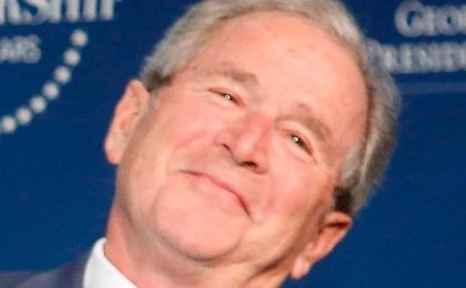 Former U.S. President George Bush has a mansion and is looking real happy.