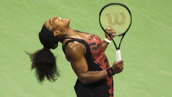 Serena Williams celebrates after defeating her sister Venus Williams in their quarterfinals match at the U.S. Open Championships.