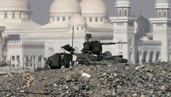 A tank stands close to the Presidential Palace in the capital city of Sanaa