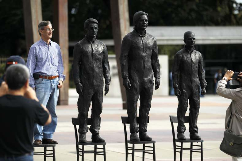 "​People take pictures with the installation ""Anything to Say?"", a bronze sculpture representing whistleblowers Edward Snowden, Julian Assange and Chelsea Manning on the Place des Nations in front of the United Nations European headquarters in Geneva, Switzerland Sept. 14, 2015."