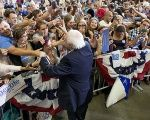 U.S. Democratic presidential candidate Sen. Bernie Sanders greets supporters as he campaigns in Greensboro, North Carolina, Sept. 13, 2015.