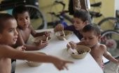 Honduran children have meals at the Todo por ellos (All for Them) immigrant shelter in Tapachula, Chiapas, in southern Mexico, June 26, 2014.