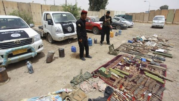 Iraqi security forces display vehicles and weapons seized from the Islamic State group